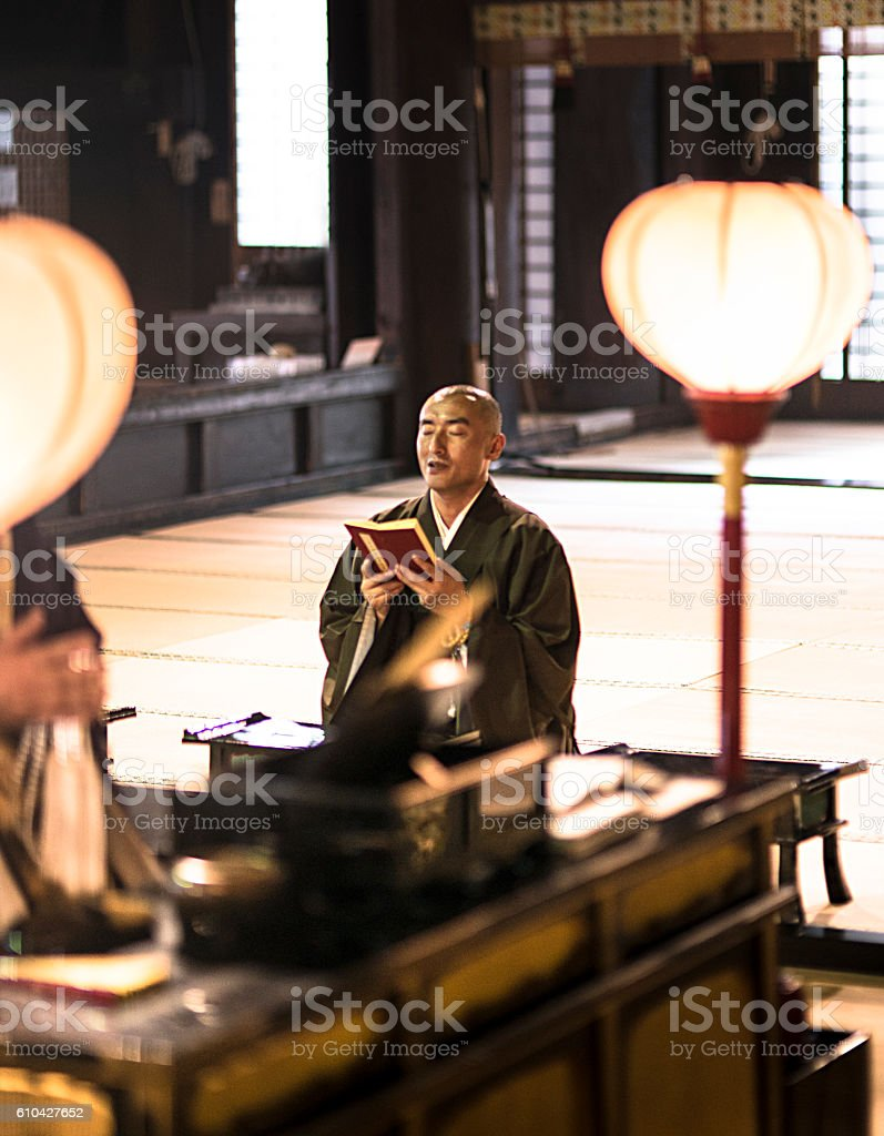 monk praing at the temple stock photo