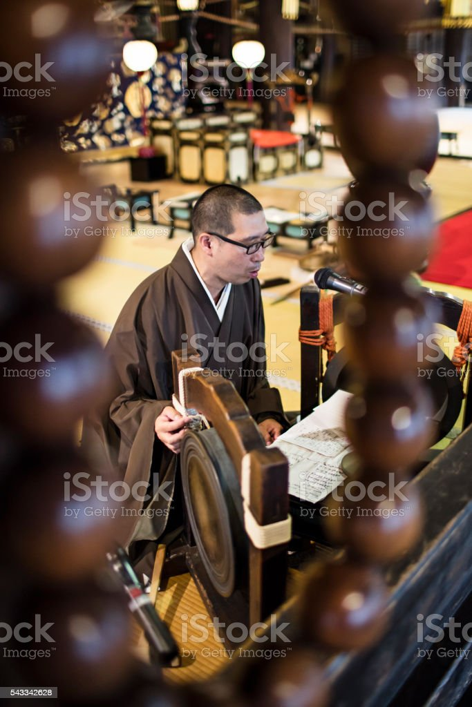 Monk praying in a Japanese temple stock photo