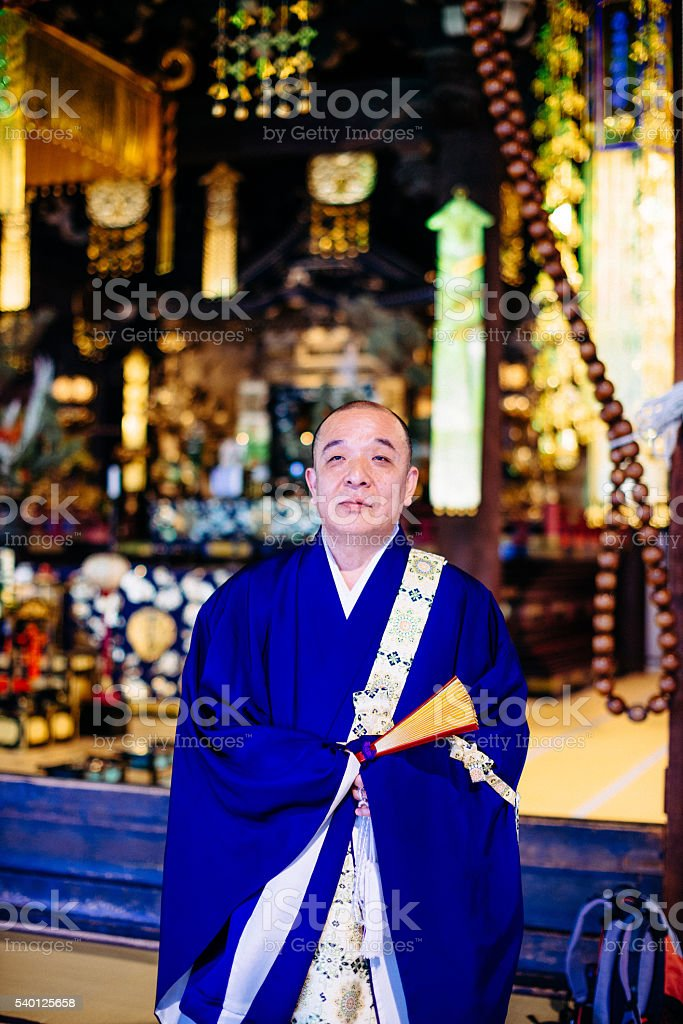 Monk praying in Buddhist shrine in Kyoto stock photo