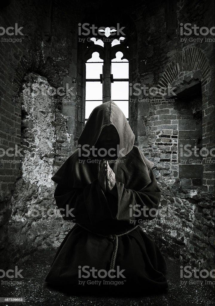 Monk praying stock photo