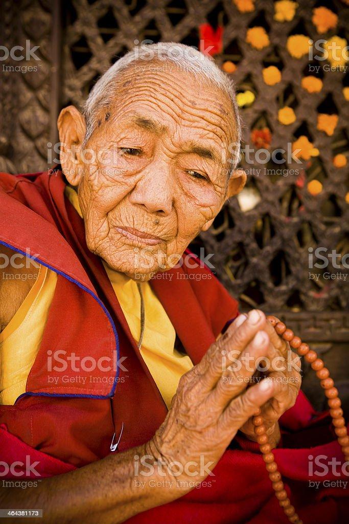 Monk praying prayer beads royalty-free stock photo