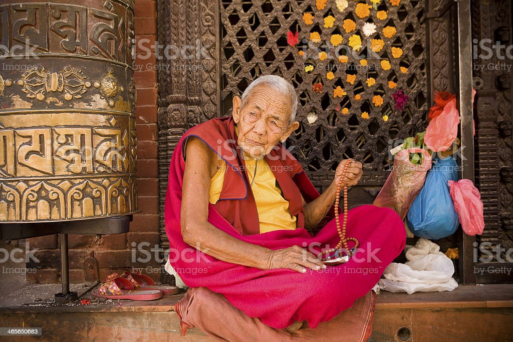 Monk praying prayer beads royalty-free stock photo