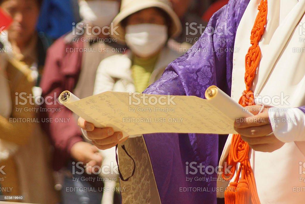 Monk reading at Fire Walking Festival in Miyajima stock photo