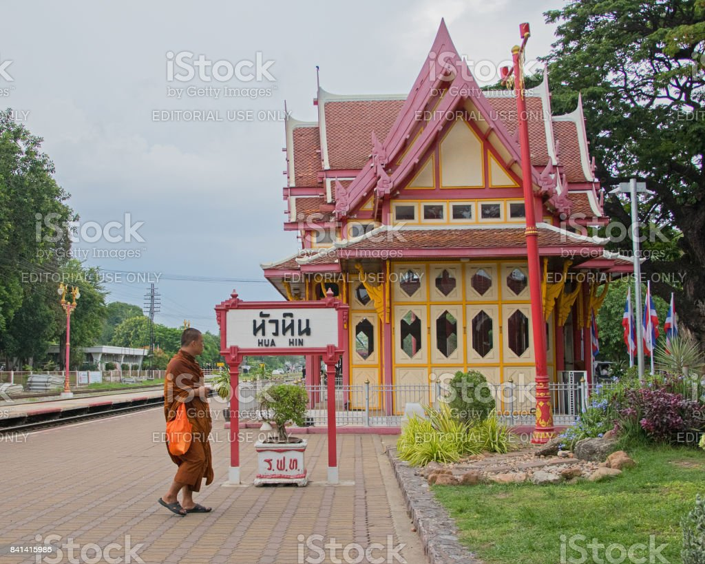 A monk walking at Hua Hin train station, Thailand stock photo