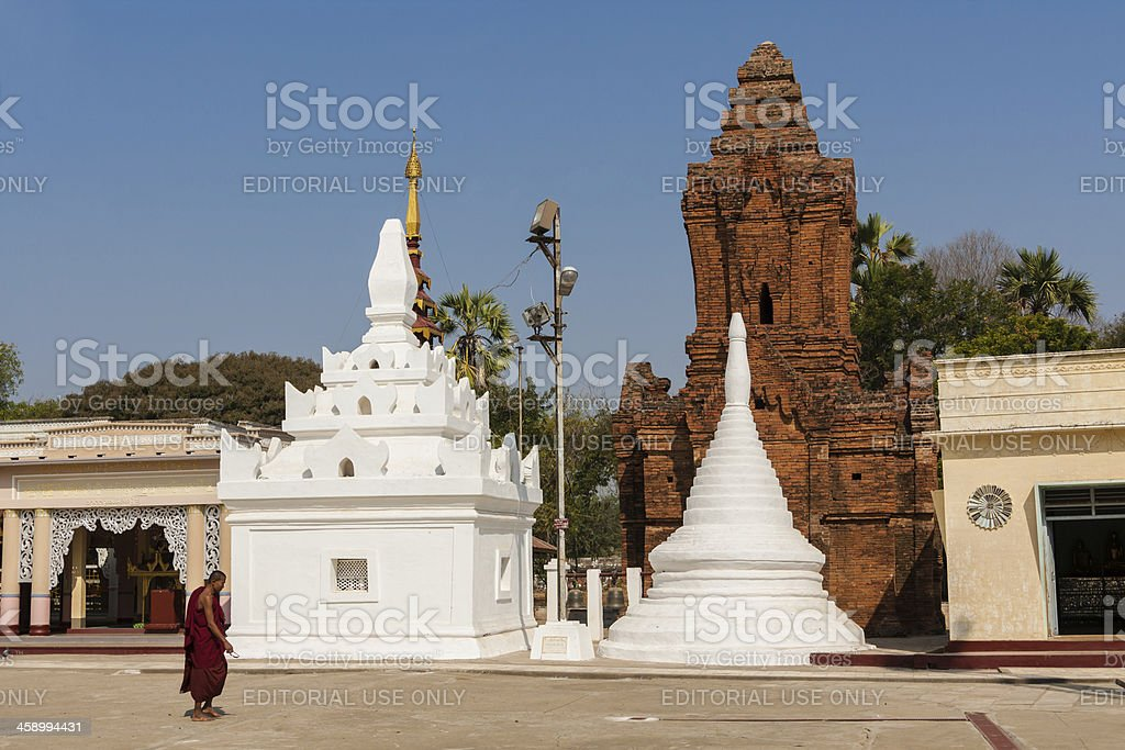 Monk walking in Shwezigon Paya royalty-free stock photo