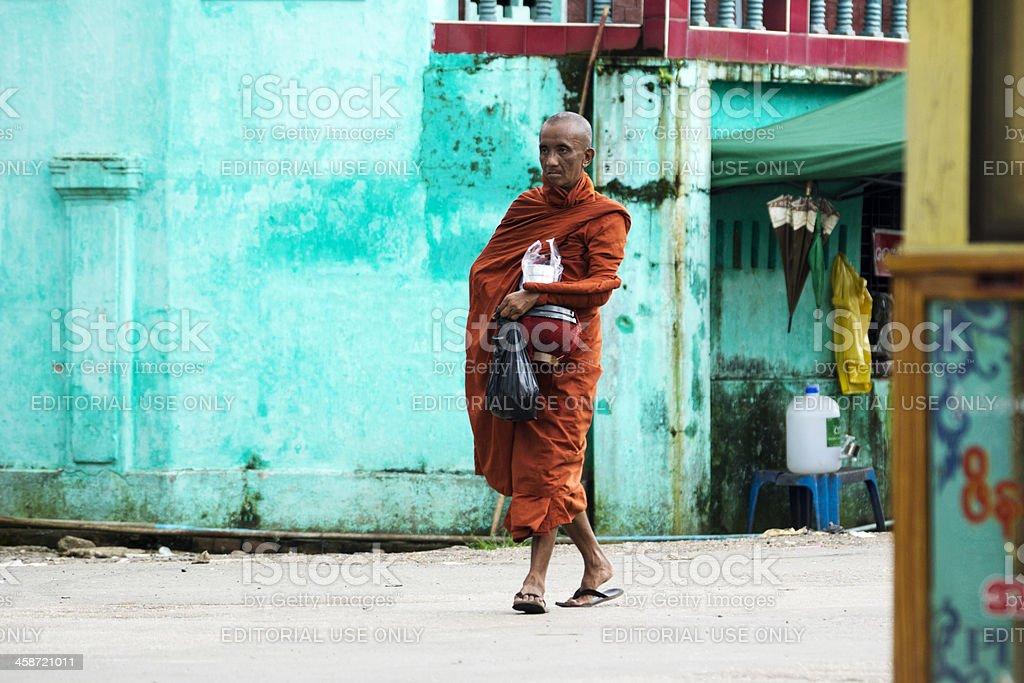 Monk walking in street Yangon stock photo