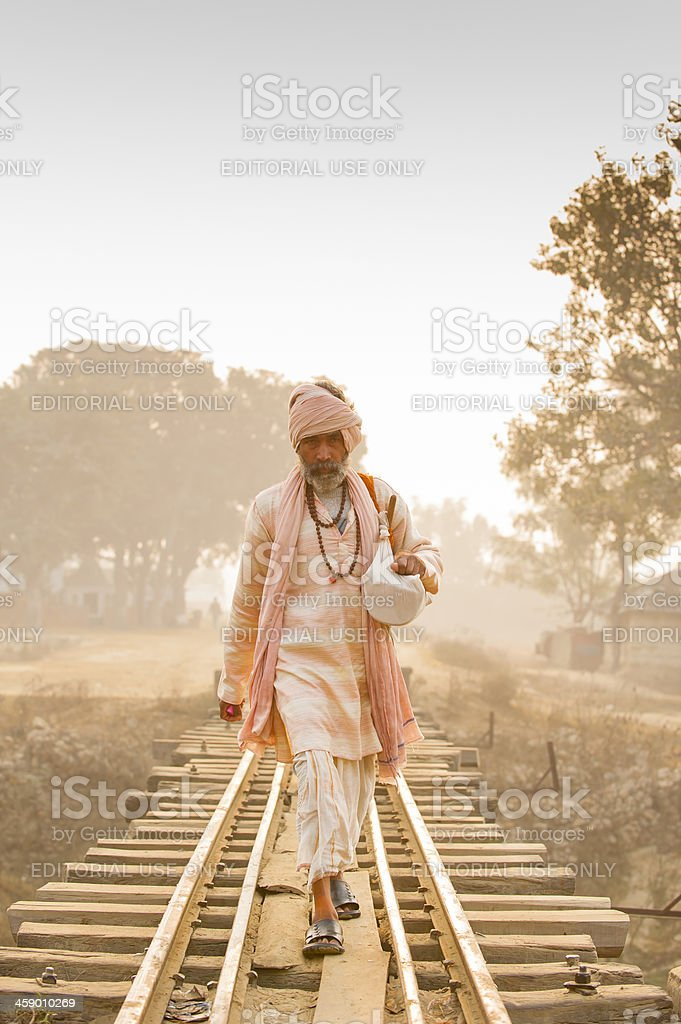 Monk walking on the railway in misty morning royalty-free stock photo