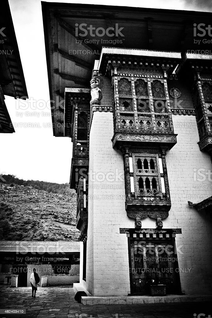 Monk walks in The Punakha Fortress Monastery, Paro, Bhutan stock photo