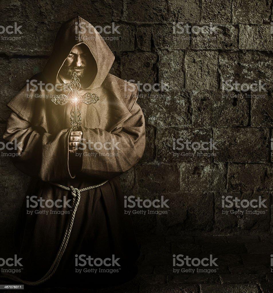 Monk with cross stock photo