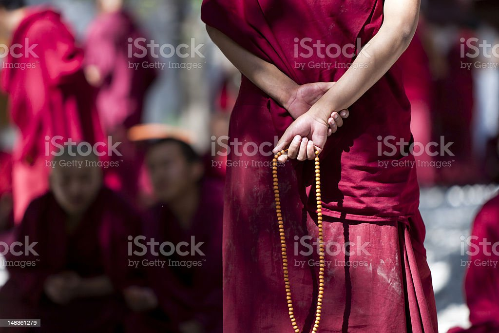 monk with prayer beads stock photo