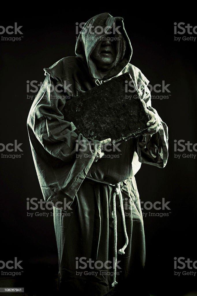 monk with secrets stock photo