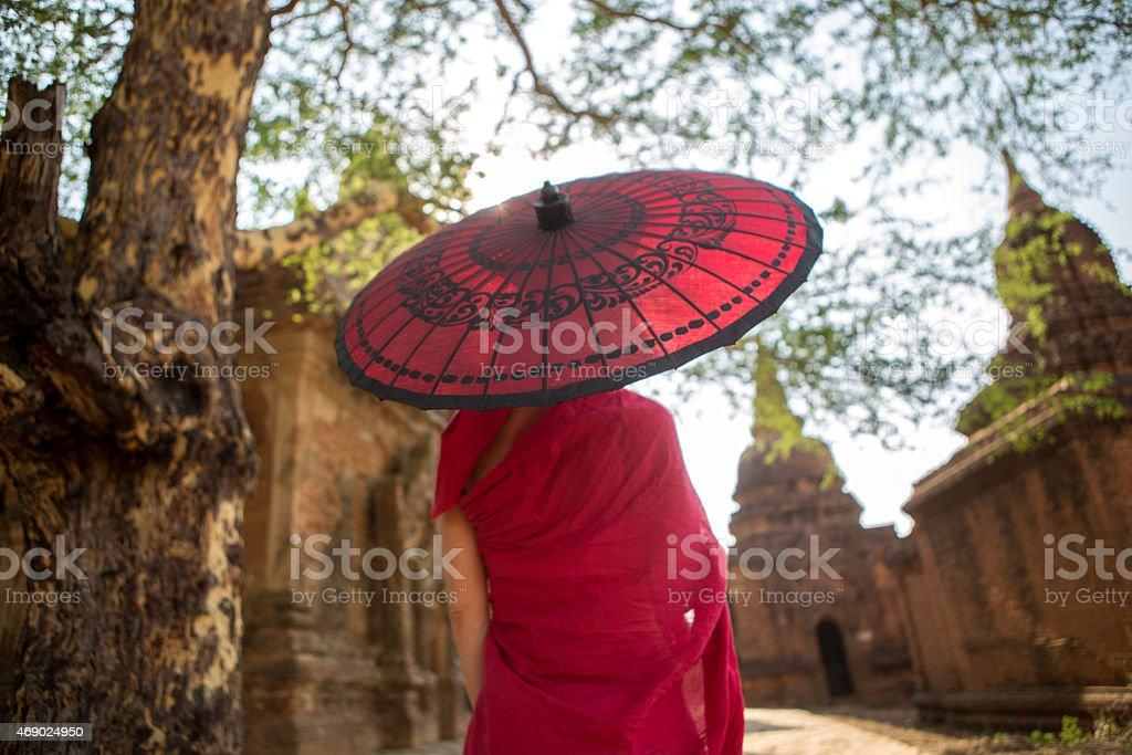 Monk with Umbrella at Bagan Temples, Myanmar. stock photo