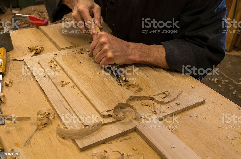 Monk working in his workshop of joinery stock photo