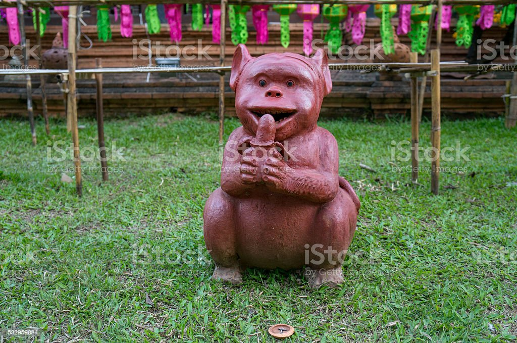 Monkey figurine in front ofa temple in Chiang Mai stock photo