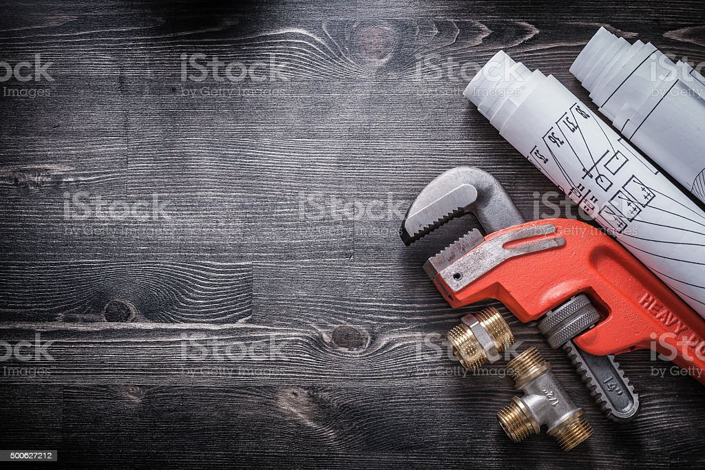 Monkey wrench brass plumbing fittings construction plans stock photo