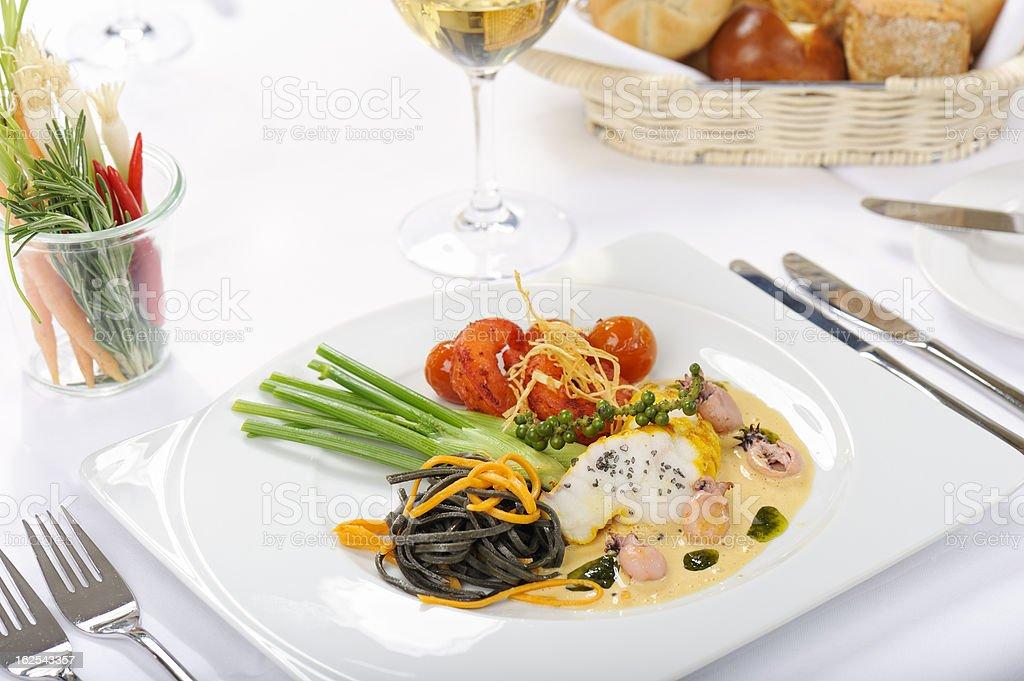 Monkfish in White Tomato Sauce with Pasta stock photo