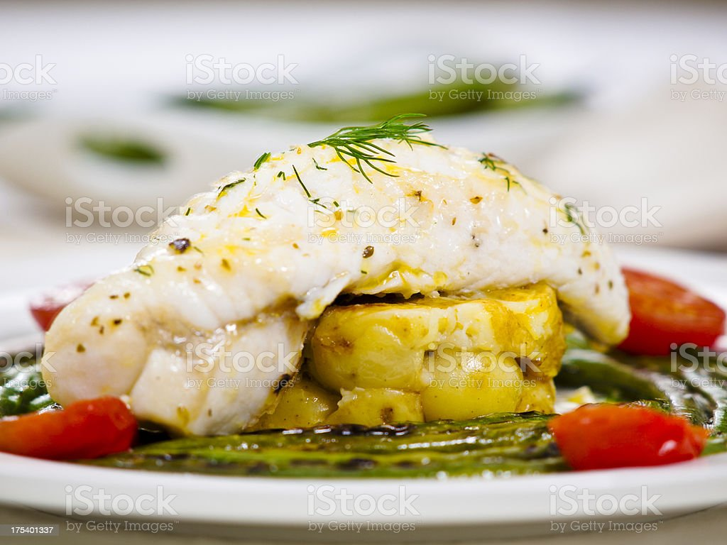 monkfish tail and grilled beans stock photo