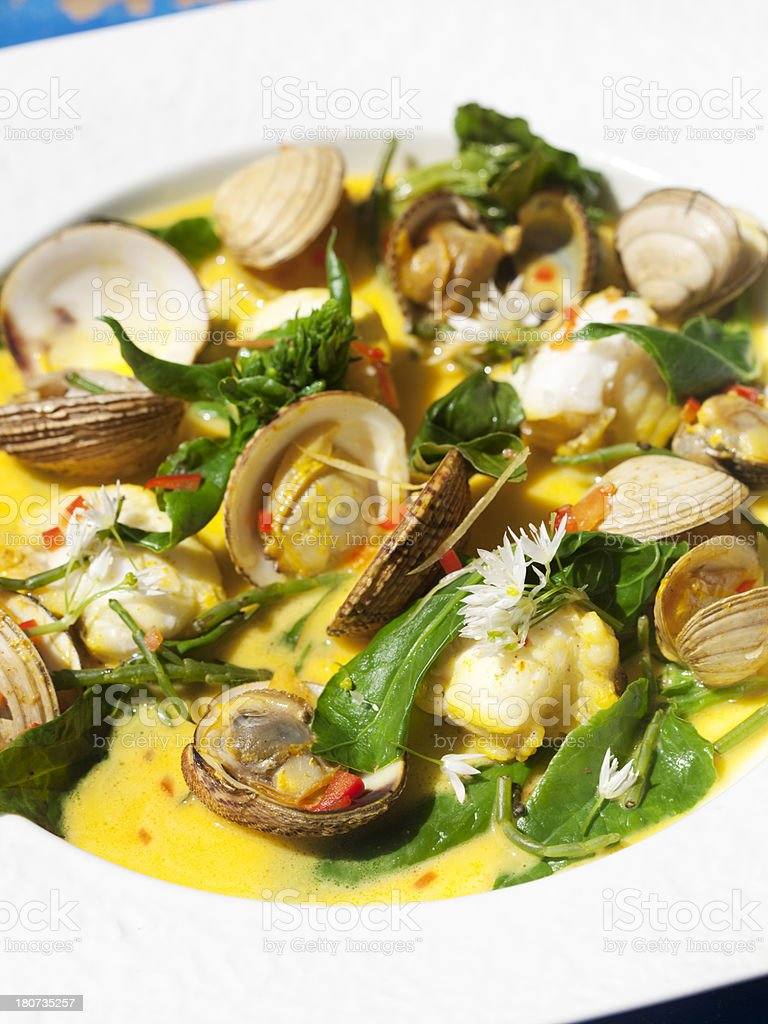 monkfish with clams and cockles stock photo