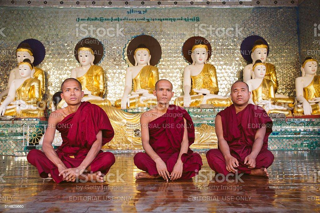 Monks and Buddha-statues in Shwedagon pagoda, Yangon stock photo