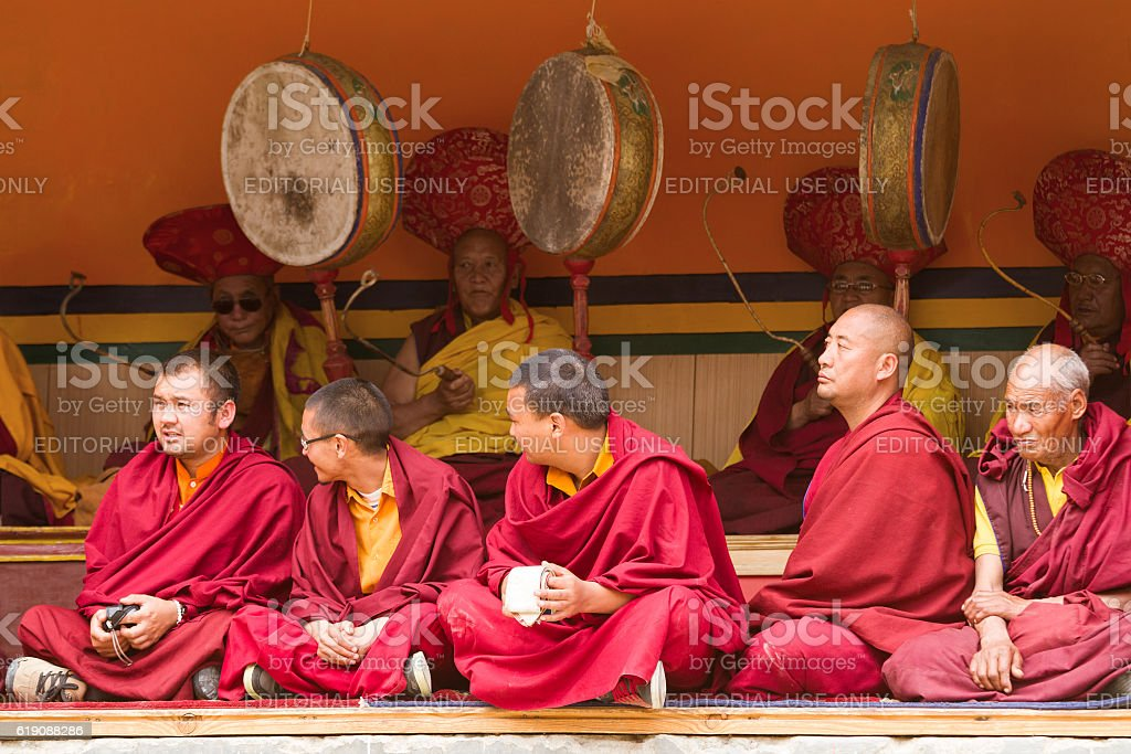 Monks as attentive spectators and ritual festival drummers. Lamayuru monastery stock photo