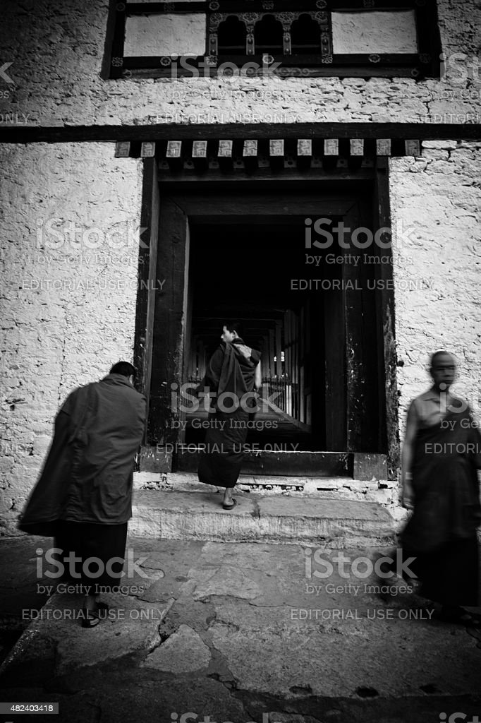Monks at the entrance of Punakha Fortress Monastery, Paro, Bhutan stock photo