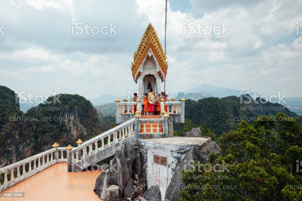 Monks at the Tiger Cave Mountain, Thailand stock photo