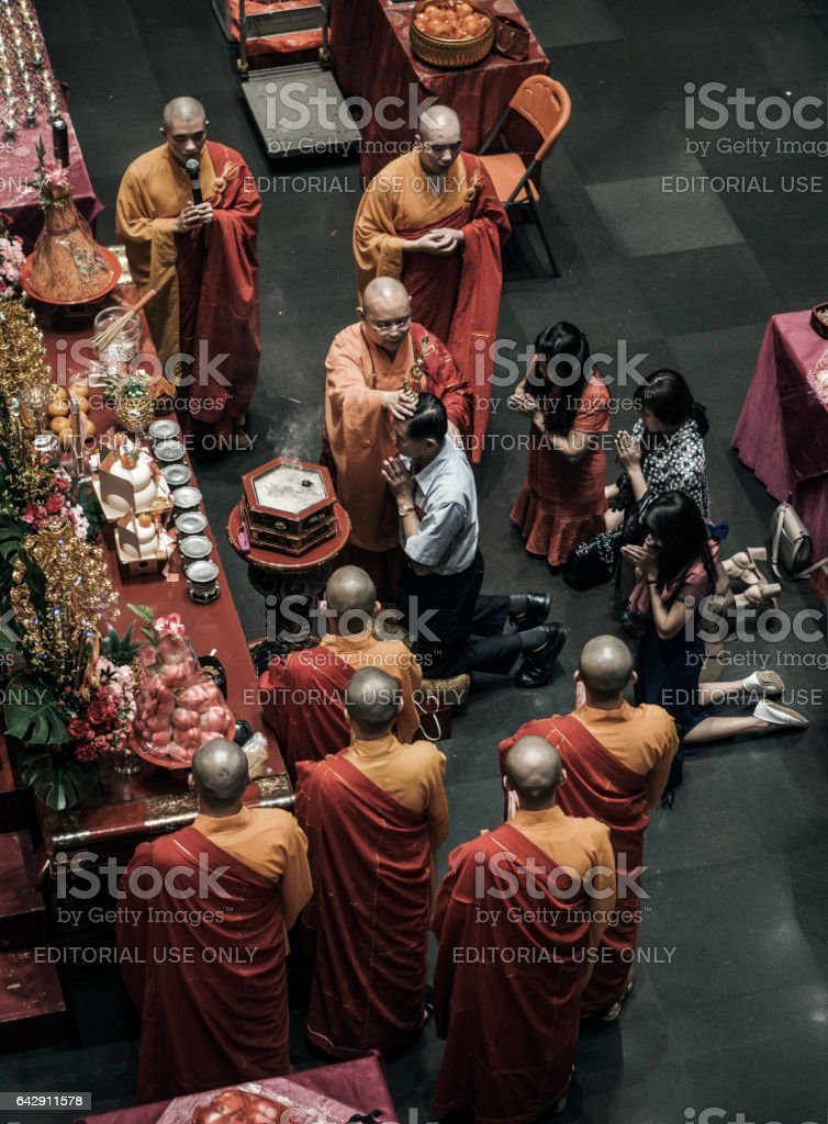 Monks blessing people in the Buddha Tooth Relic temple Singapore stock photo