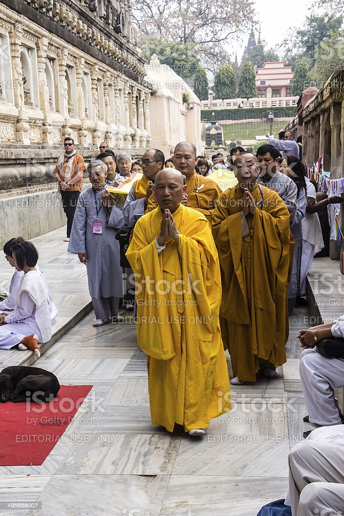 monks circeling Mahabodhi temple, India stock photo