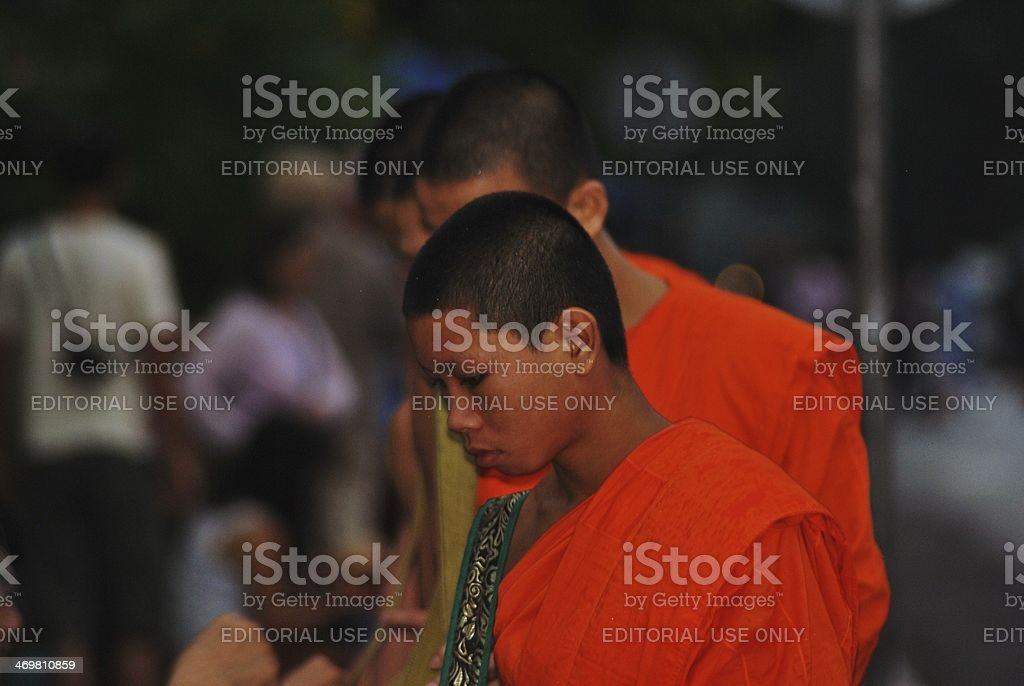 Monks Collect Alms in Luang Prabang stock photo