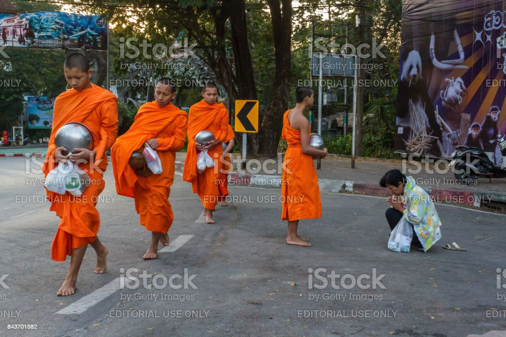 Monks collect donations in Chiang Mai, Thailand stock photo