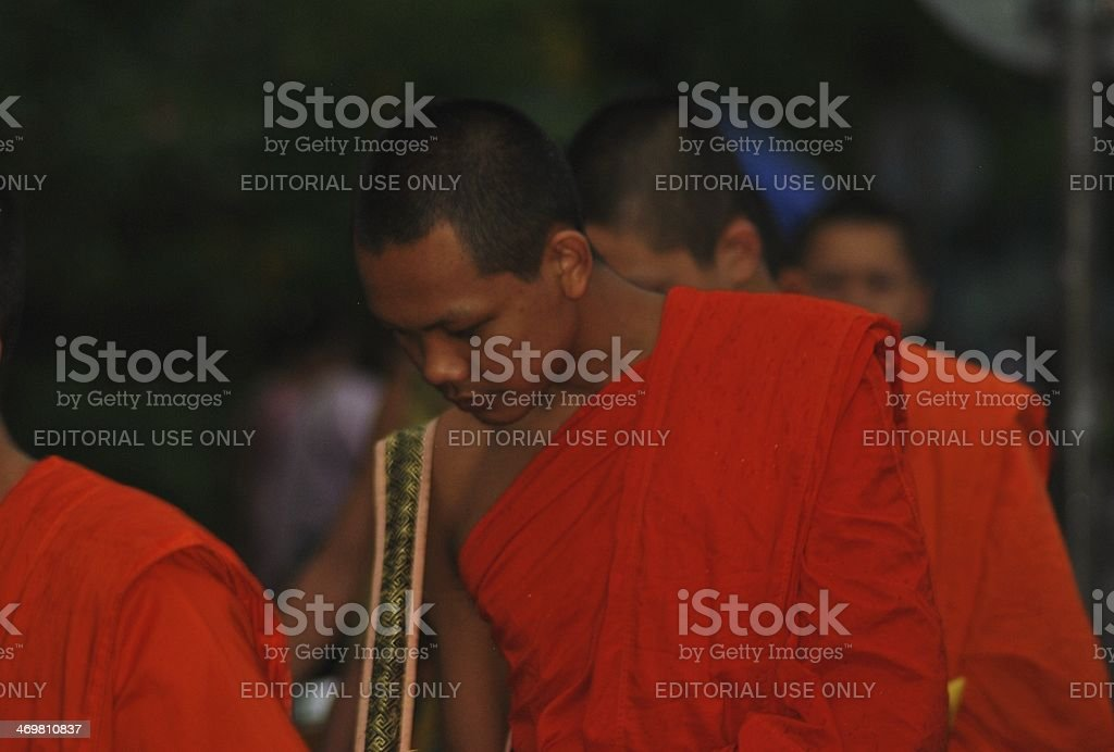 Monks Collecting Alms At Dawn, Laos stock photo