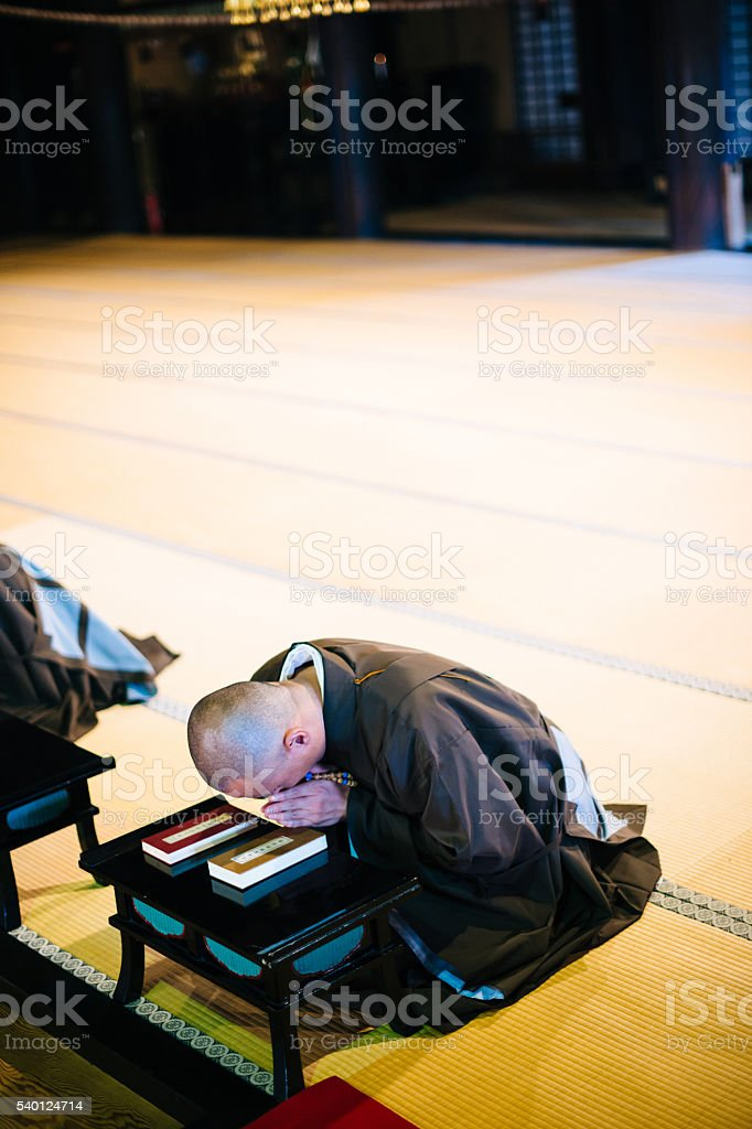 Monks during prayer in Buddhist shrine in Kyoto stock photo