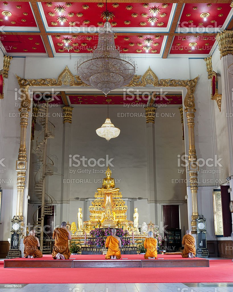 monks meditating and praying in Buddhist temple Bangkok Thailand royalty-free stock photo