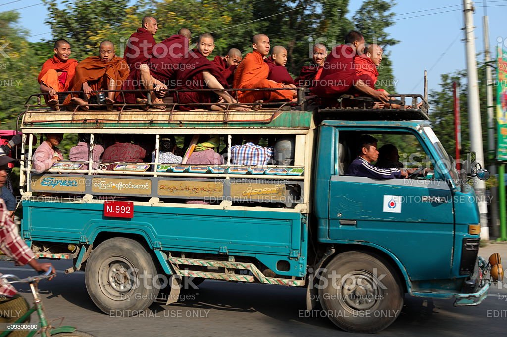 Monks on a Truck in the Traffic of Myanmar stock photo