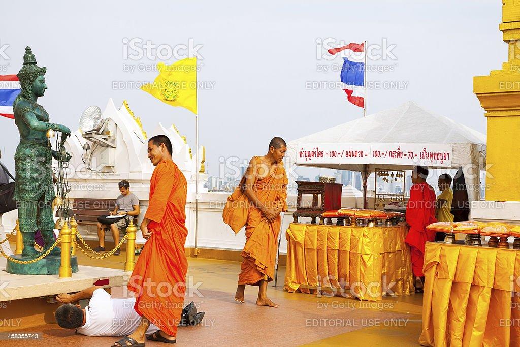 Monks on roof of Wat Saket stock photo