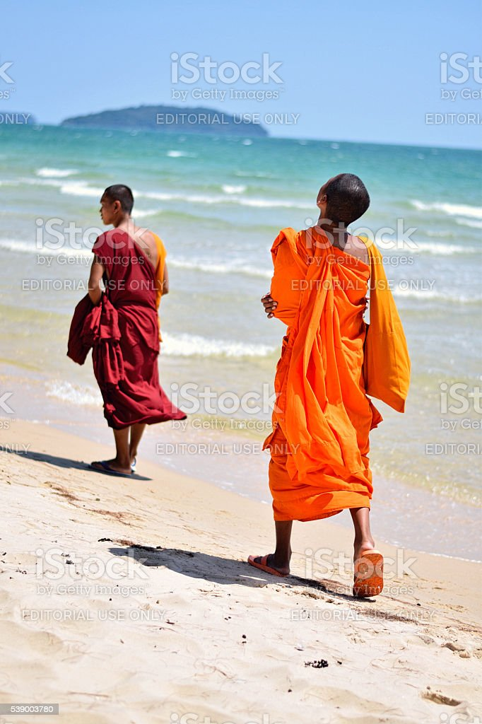 Monk's On The Beach In Cambodia stock photo
