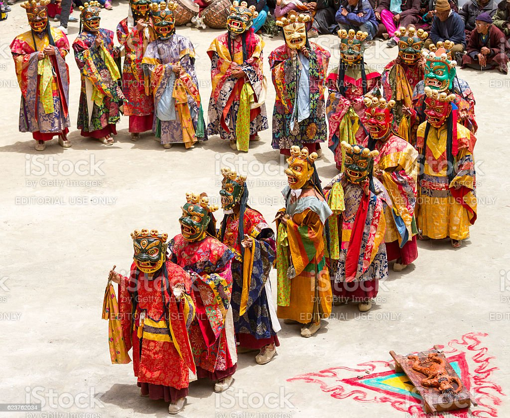 Monks perform sacred masked mystery dance of Tibetan Buddhism stock photo