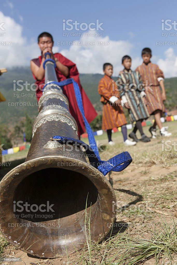 Monks play traditional horn at Wangdi Festival stock photo