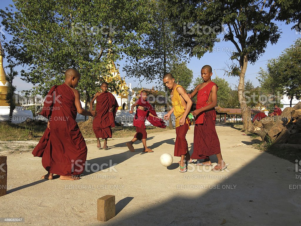 monks playing soccer in Kalaw temple Myanmar royalty-free stock photo