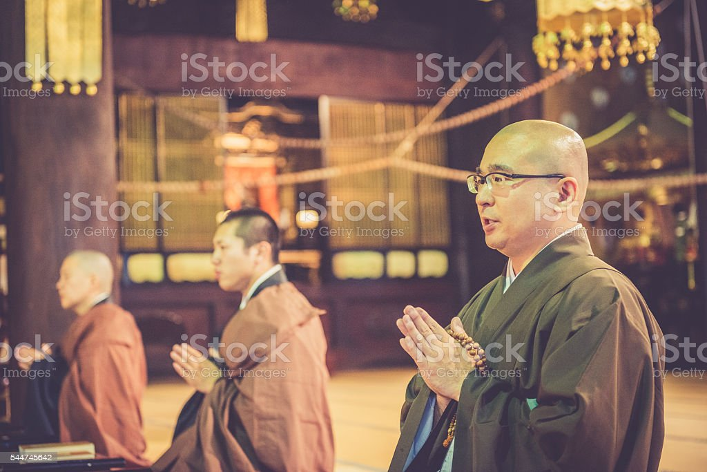 Monks Praying at Buddhist Chion-ji Temple in Kyoto, Japan stock photo