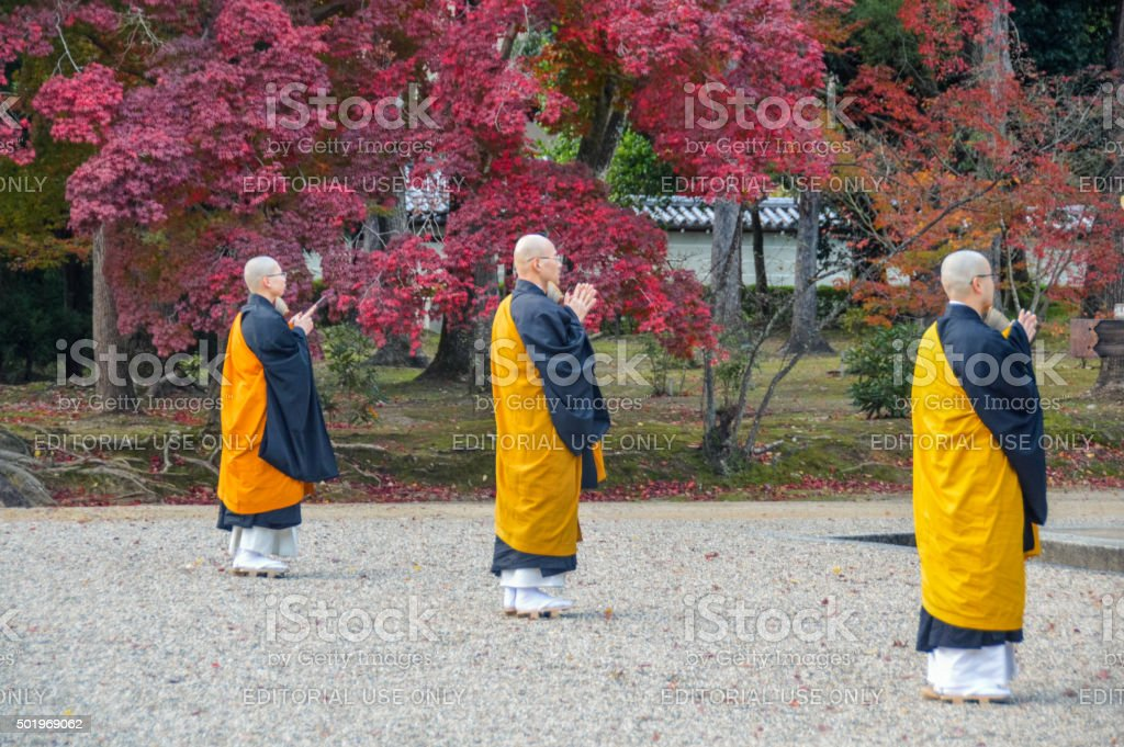 Monks praying at the Ninna-ji Temple in Kyoto, Japan stock photo