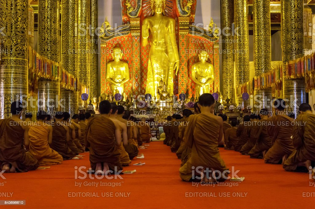 Monks praying at Wat Chedi Luang temple in Chiang Mai, Thailand stock photo
