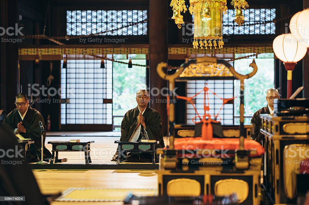 Monks praying in a Japanese temple stock photo
