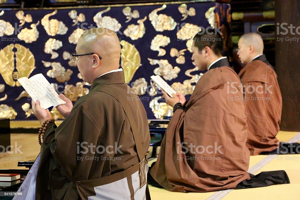 Monks praying stock photo