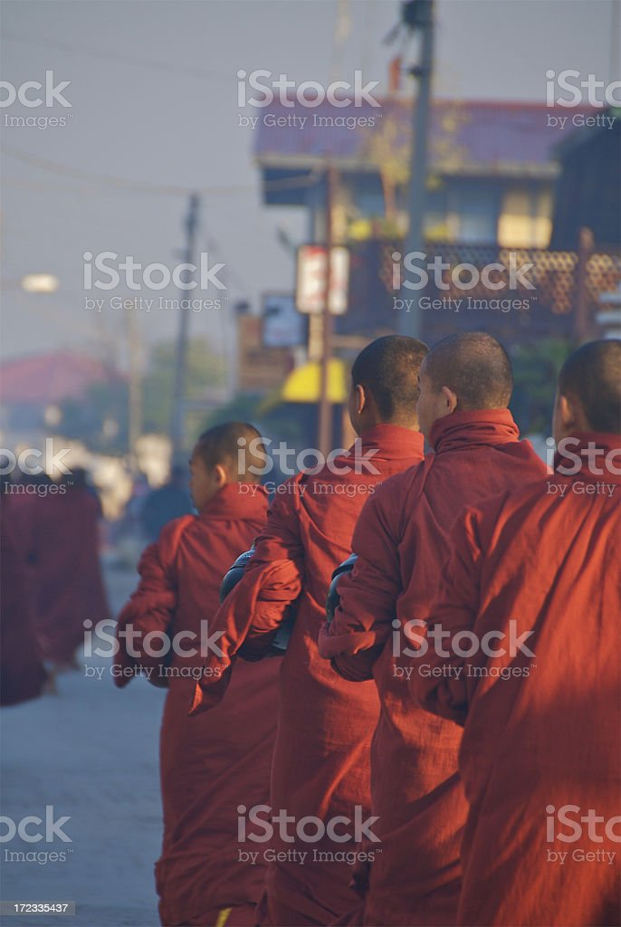 Monks queuing up for food in the morning royalty-free stock photo