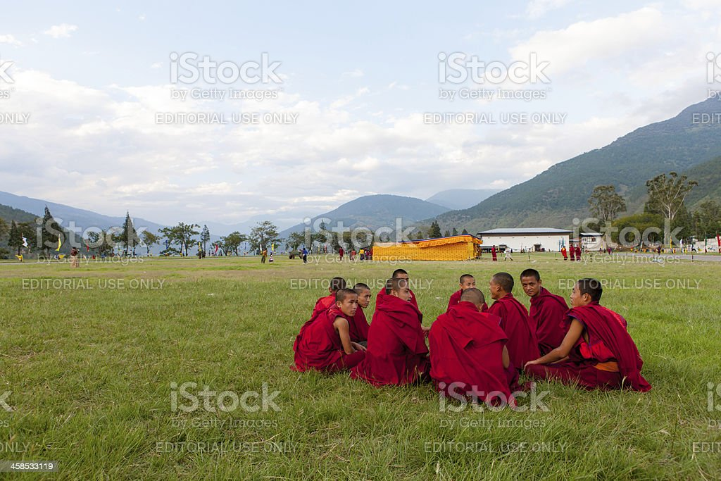 Monks relax after attending the festival in Wangdi stock photo