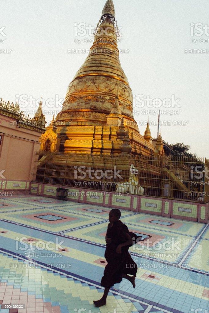 Monks running inside Buddhist monastery stock photo