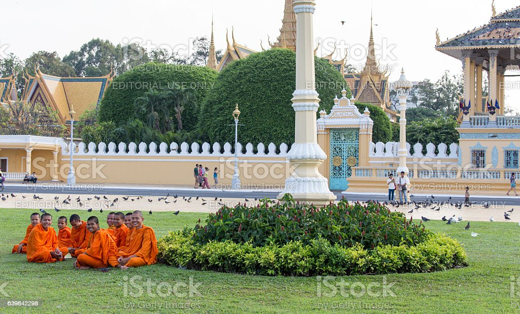 Monks tour the Royal Palace grounds in Phnom Penh stock photo