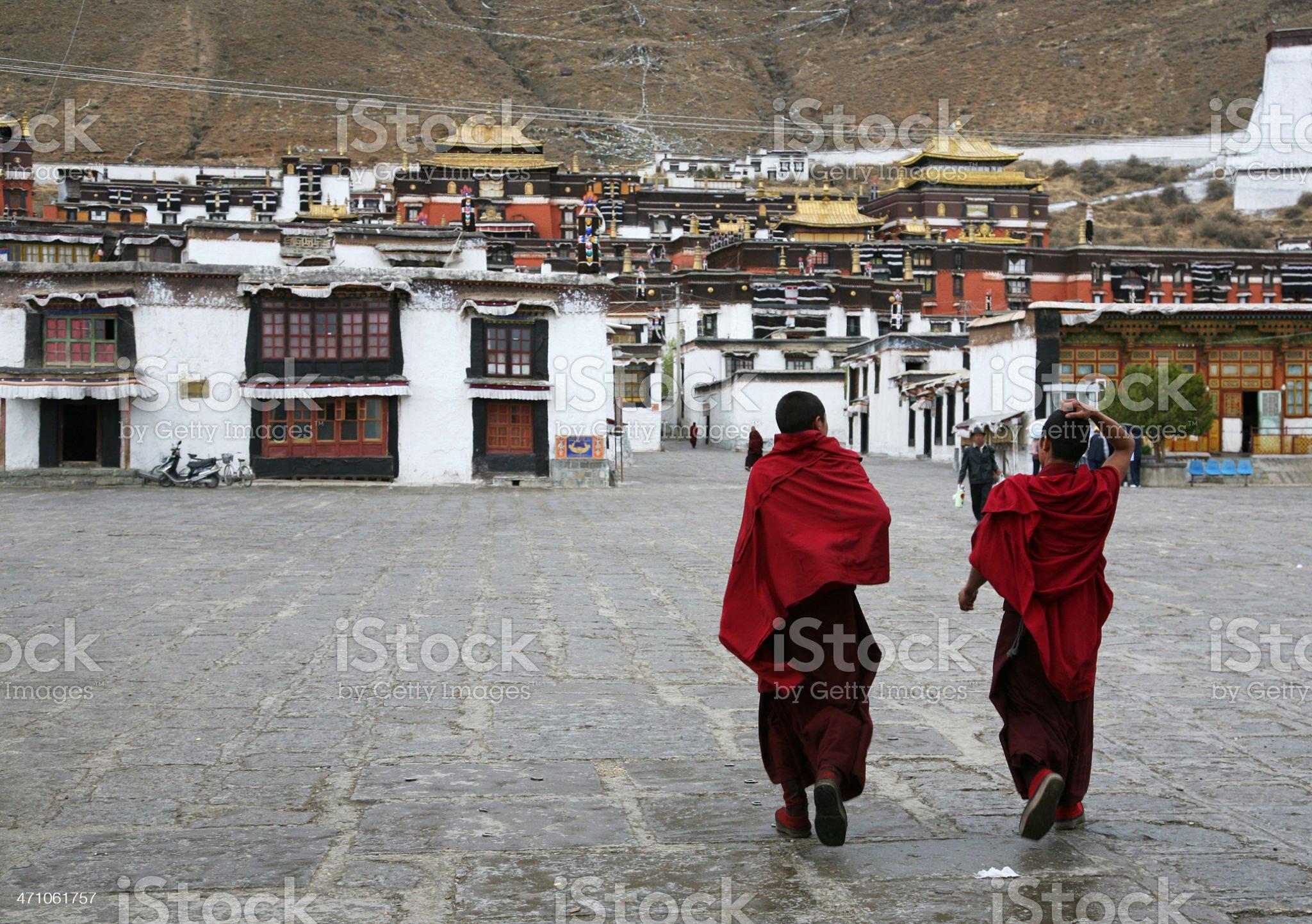 Monks Walking In Tashilhunpo Monastery royalty-free stock photo
