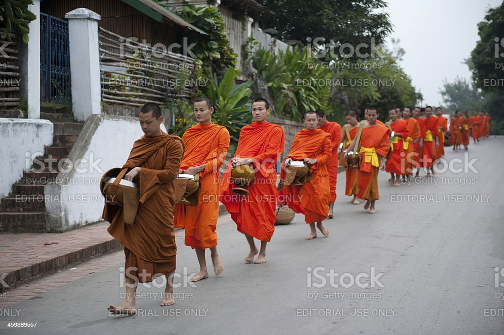 Monks walking on a street stock photo